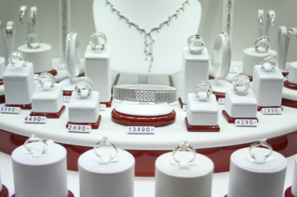 Assorted display of fine diamond and platinum necklaces, earrings and rings.