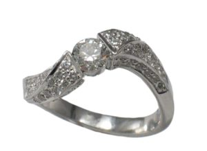 A diamond Ring with delicate carvings.