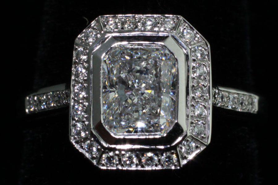 Beautifully Cut Diamond Surrounded by Smaller Diamonds