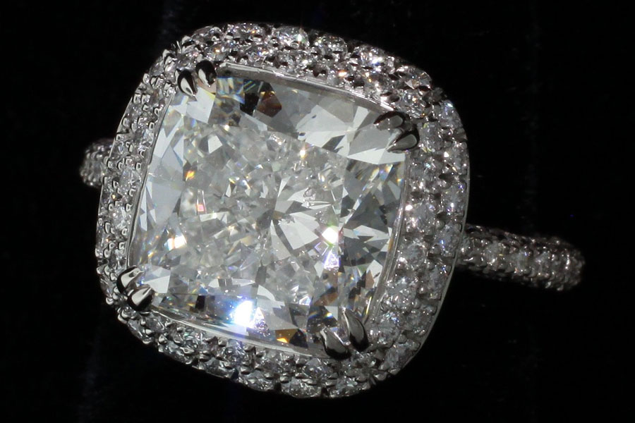 Diamond ring surrounded by melee diamonds.